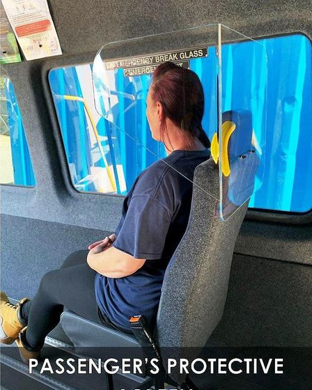A minibus passenger sitting behind a protective screen. Picture: Uttlesford Community Travel