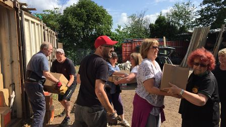 A team of volunteers worked together to load last year's shipping container with thousands of books