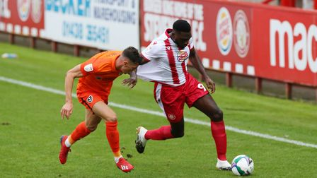 James Bolton of Portsmouth pulls back Inih Effiong of Stevenage. Picture: DANNY LOO/TGS PHOTO
