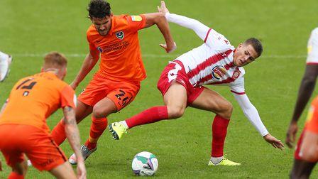 Charlie Carter of Stevenage battles for the ball with Gareth Evans of Portsmouth during the Carabao