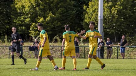 Layne Eadie receives the congratulations after scoring the only goal in Hitchin Town's 1-0 win at St
