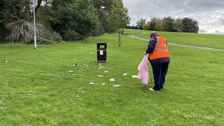 Cllr Paul Clark picking litter on Hitchin's Windmill Hill. Picture: Amy Thorburn