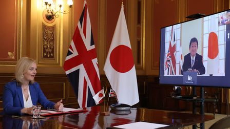 International Trade Secretary Liz Truss speaking to Japan's Minister for Foreign Affairs Toshimitsu