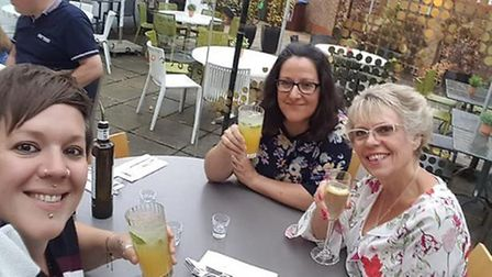 Vicky (left) with her wife Naomi (centre) and mum Wendy. Picture: Courtesy of Naomi Lovelace-Collins