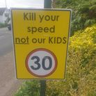 Residents of Norton Road have been displaying these road signs outside their homes to reduce speed.
