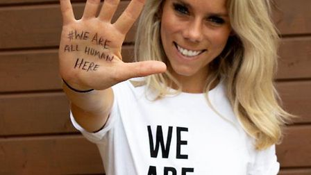Rebecca Dudbridge, from @BambuuBrush, poses with Humanitas's 'We Are All Human Here' campaign t-shir