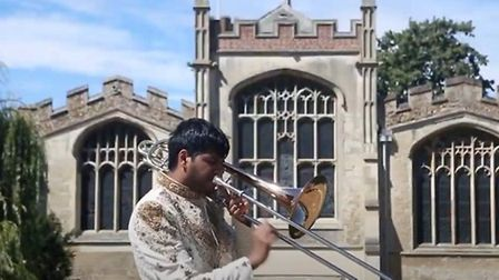 Andeep Birring, bass trombone player, performs as part of Hitchin Band's winning entry to the Cory O