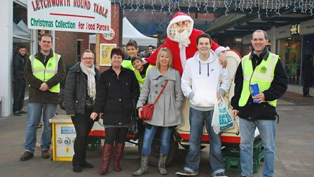 Santa in the Round Table sleigh, joined by members of the Round Table, junior helpers and members of