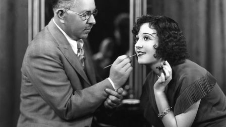 Max Factor, Polish businessman and founder of cosmetics company, Max Factor, demonstrates the techni