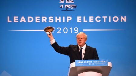 Conservative Party leadership candidate Boris Johnson brandishes a kipper during the final Tory leadership hustings