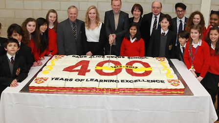 Gary Kemp cuts the cake to celebrate Dame Alice Owen's School 400th anniversary, with students and s