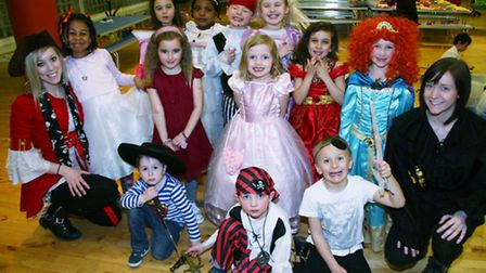 Play leaders Emma Scott and Hannah Donaghy with youngsters dressed as princesses and pirates