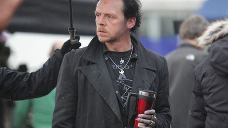 Simon Pegg, with dark hair and wearing a long black coat, as Gary King during fiming of The World's