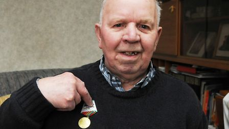 Arctic Convoy veteran Reginald Young with his medal from the Russian government