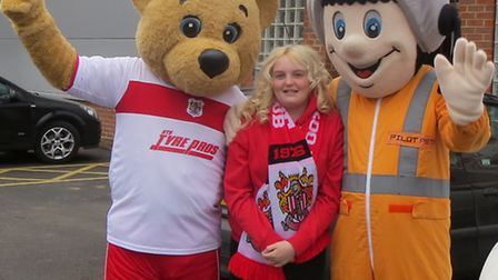 Poppy Young with Stevenage FC and Herts Air Ambulance mascots