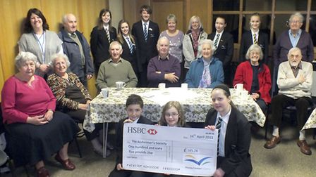 Thomas Clarkson Academy our students visiting the Wisbech Alzheimer's Society and presented a cheque