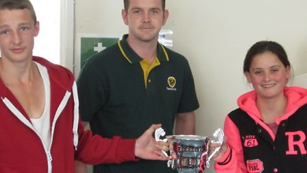 Ben Wiles presents the trophy to Paul Dent and Kim Watkin.