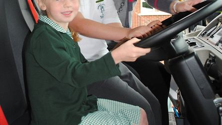 In the driving seat are, from left to right, pupils Lillie-Anne Garvey, Fern Kemp and Cllr Jean Heyw