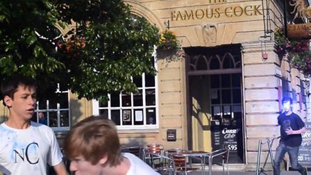 Idris Miles and James flee from a robot outside 'The Famous Cock' aka The Cork