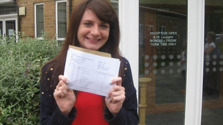 Chancellor's School's head student, Clare Roper, celebrating her A Level results including A* in His