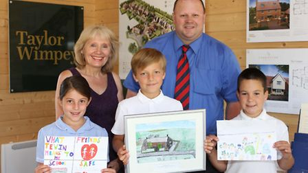Competition winners Tyler Owens (centre), Hannah Stapleton and Max Seewraj with Frances Trayner–Cole