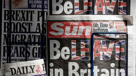 "Copies of ""The Sun"" newspaper sit on a news stand before the EU referendum. Photograph: Luke MacGreg"