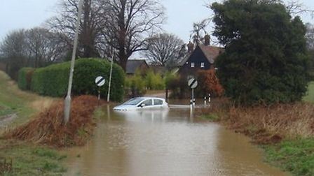 A car appears to have been abandoned in Woolmer Green after attempting to traverse a flooded road. P