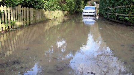 Abandoned car in Robbery Bottom Lane after Friday's flooding