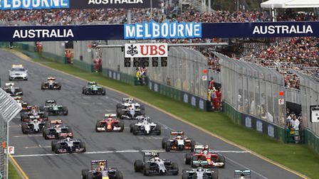 Lewis Hamilton leads the 2014 Australian Grand Prix from pole position ahead of Mercedes teammate Ni