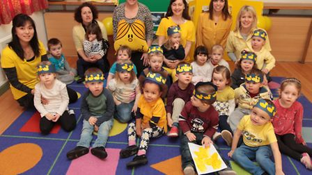 Staff and Children supporting big yellow Friday