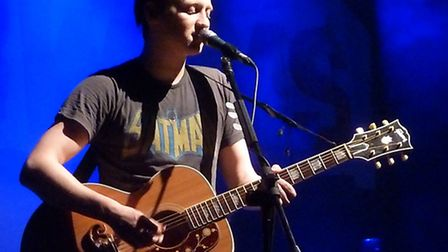 Billy Lunn performs an acoustic track during the encore of The Subways' set at the Forum Hertfordshi