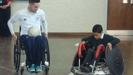 The youngsters get shown the ropes by wheelchair rugby ace Chris Ryan