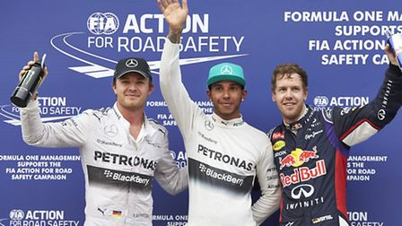 Lewis Hamilton (centre) won the 2014 Malaysian Grand Prix from Nico Rosberg (left) and third-placed