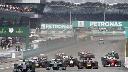 Mercedes driver Lewis Hamilton gets away from pole position at the start of the 2014 Malaysian Grand