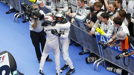 Mercedes drivers Lewis Hamilton and Nico Rosberg celebrate the team's one-two in the 2014 Malaysian