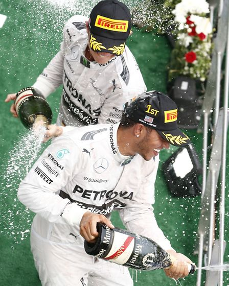 Mercedes drivers Nico Rosberg and Lewis Hamilton on the 2014 Malaysian Grand Prix podium [Picture: M