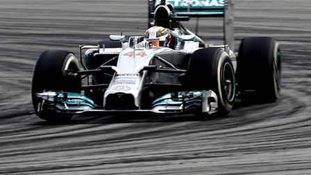 Lewis Hamilton driving around the Sepang circuit in practice ahead of the 2014 Malaysian Grand Prix