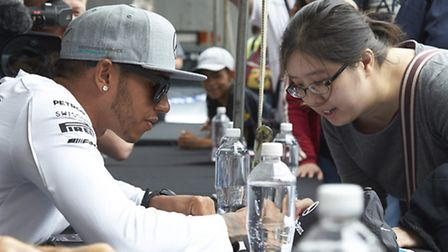 Lewis Hamilton signing autographs for fans in Montreal ahead of the 2014 Canadian Grand Prix [Pictur