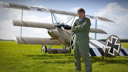 Iron Maiden frontman Bruce Dickinson will pilot his Fokker Dr1 Triplane over Knebworth during this y