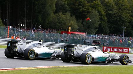Nico Rosberg goes wheel-to-wheel with Mercedes rival Lewis Hamilton in the 2014 Belgian Grand Prix a
