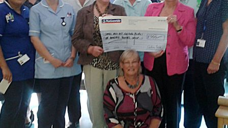 Liz and Roy McManus presented a cheque for £500 to Trafford Ward Wisbech ,
