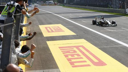 Lewis Hamilton takes the chequered flag in the 2014 Italian Grand Prix at Monza [Picture: Mercedes-B