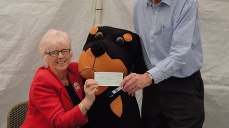 Mavis Pett of Norfolk Hospice receiving a cheque from Nigel Elgood, Chairman of Elgood & Sons Ltd.