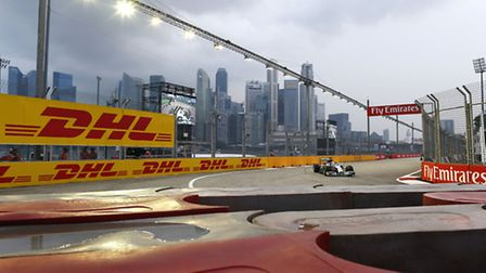 Mercedes F1 racer Lewis Hamilton driving around the Marina Bay Street Circuit ahead of the 2014 Sing