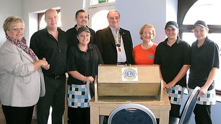 Jolley Fryer fund raiser. Adrian Jarvis ,second left, with staff and members of the Lions Club makin