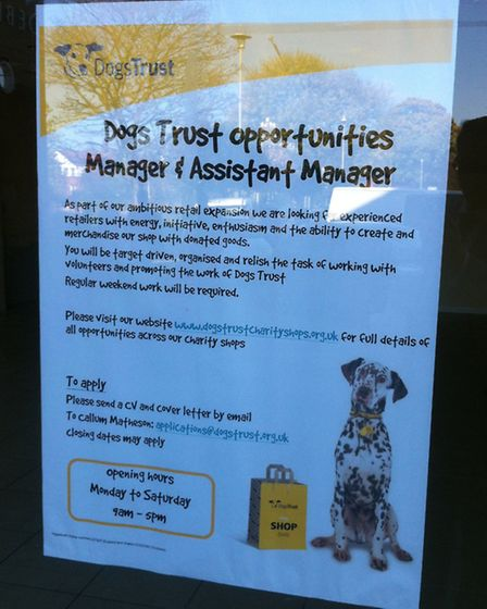 A sign saying the unit will become a Dogs Trust charity shop