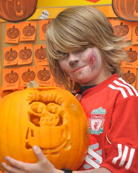 Sue Ryder Halloween charity event at Morrisons, Wisbech. Ronnie Kilby with one of the pumkins on sho