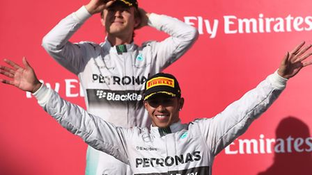 Lewis Hamilton and Nico Rosberg on the podium after completing a Mercedes one-two in the 2014 United