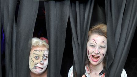 New beginnings charity for adults with disabilities decked out for Halloween. Left: Support workers,