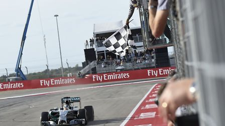 Lewis Hamilton takes the chequered flag to win the 2014 United States Grand Prix in Austin, Texas [P